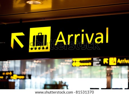 Brightly light arrival airport information sign - stock photo