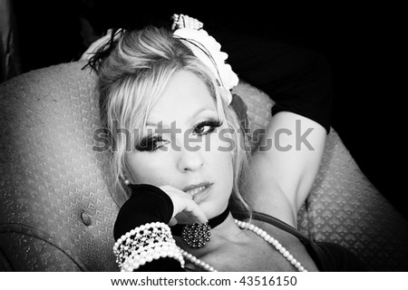 brightly lit black and white image of woman's face as she looks off to the side. - stock photo