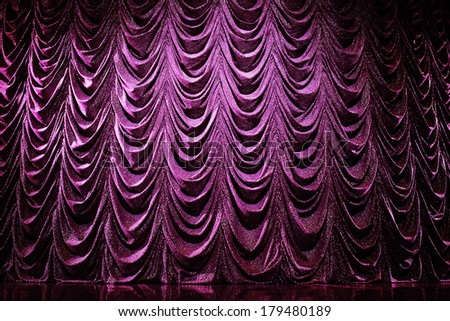Brightly lit curtains in theatre - stock photo