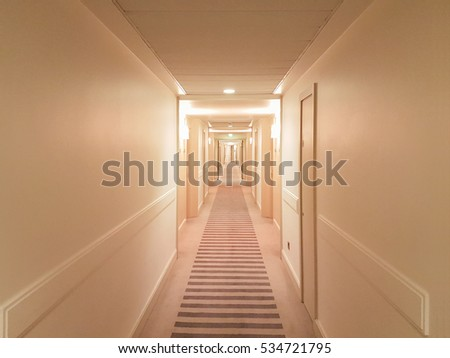Brightly lit hallway typical for hotels and hostels