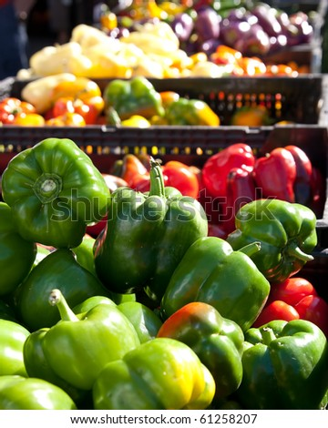 Brightly lit, multicolored selection of peppers for sale in a stand at the Reston VA Farmers market - stock photo