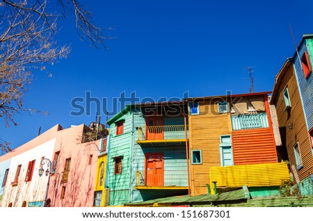 Brightly painted buildings in La Boca neighborhood of Buenos Aires, the birthplace of Tango - stock photo
