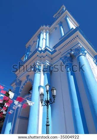 Brightly painted church in the town of San Cristobal de las Casas, Chiapas, Mexico. - stock photo