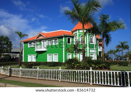 Brightly painted green clapboard building at Samana in the Dominican Republic - stock photo