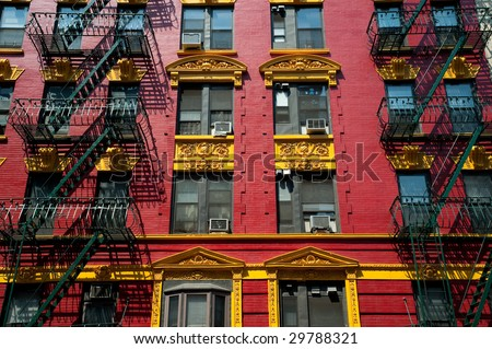 Brightly painted red and yellow building in Chinatown in New York City. - stock photo