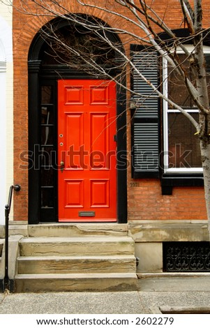 Brightly painted red front door.  Philadelphia, PA. - stock photo
