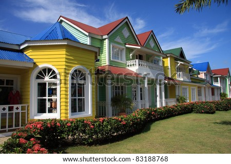 Brightly painted row of Caribbean shops in the Dominican Republic - stock photo