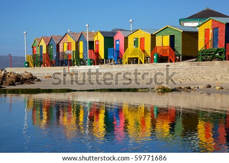 Brightly painted wooden bathing huts at St James Beach, near Cape Town, South Africa. - stock photo