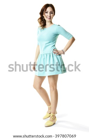 Brightly shot of young woman in sports turquoise dress. - stock photo