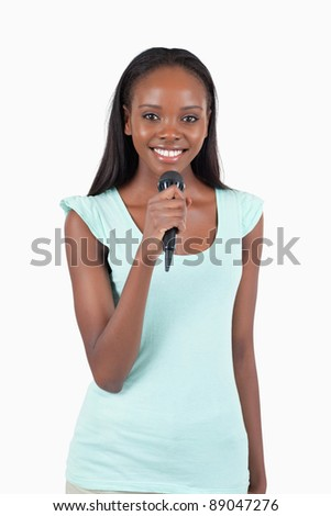 Brightly smiling female singer against a white background