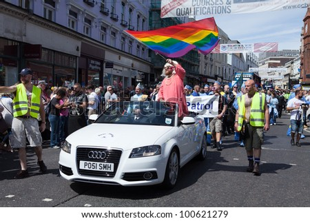 BRIGHTON - AUG 13. The Bear Patrol of the Sussex Beacon join the pride parade with a white Audi under 'The ThunderBears with Lady Bear-nelope' theme at Brighton Pride Festival on August 13, 2011. - stock photo