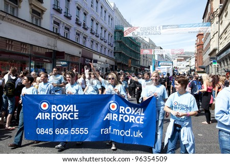 BRIGHTON, ENGLAND - AUGUST 13. Members of the Royal Air Force LGBT Community take part in the Brighton Pride Festival 2011, parading and holding an RAF Careers banner on August 13, 2011 in Brighton, England.