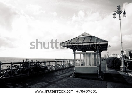 Brighton Palace Pier with streetlamps, England