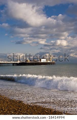 Brighton pier and coastline at sunset. - stock photo