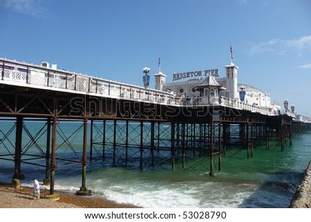 Brighton Pier in Brighton. - stock photo