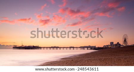 Brighton's seafront silhouetted against the sunset - stock photo