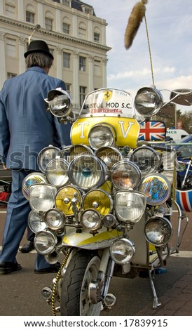 BRIGHTON - SEPTEMBER 14: Vintage Mod scooter with plenty of lights and mirrors at the famous annual Ace Cafe Reunion Run also known as the Brighton Burn-Up on September 14, 2008. - stock photo