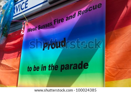 BRIGHTON, UK - AUG 13. West Sussex Fire and Rescue take part in the Pride Parade at Brighton Pride Festival on August 13, 2011, Brighton, West Sussex, England. - stock photo
