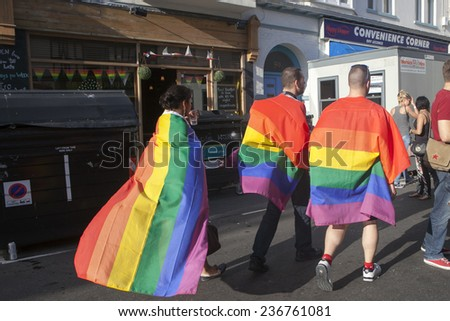 BRIGHTON, UK - AUGUST 07: Brighton Gay Pride parade. party of the 19th pride with over 15k people participating. A celebration of diversity and homosexual rights. august 07, 2014 in Brighton, UK. - stock photo