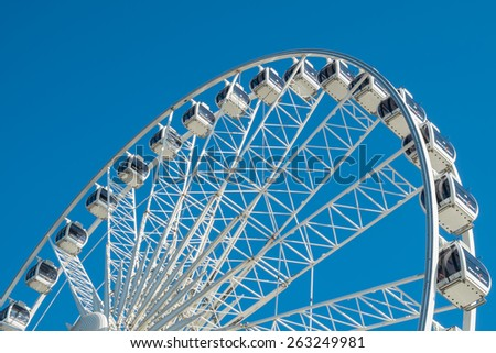 BRIGHTON, UK - JULY 28 2013: A view of the wheel on Brighton seafront, now a popular tourist attraction.  - stock photo