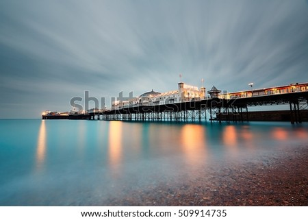 BRIGHTON, UK - OCTOBER 24, 2016: Brighton Marine Palace and Pier is popular tourist attraction, which opened in 1899. Brighton in United Kingdom at dusk on October 24, 2016.