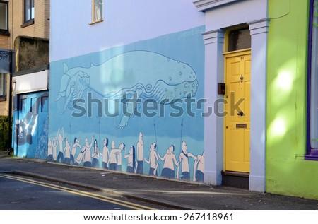 BRIGHTON, UNITED KINGDOM- MARCH 27: Street art in England, graffiti wall in Brighton, the Lanes district is well-known by its street art. Brighton, United Kingdom - March 27, 2015  - stock photo