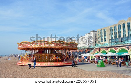 Brighton, United Kingdom - September 28, 2014: Carousel on the beach on a Summer day at Brighton on the south coast of England. - stock photo