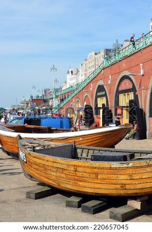 Brighton, United Kingdom - September 28, 2014: Historic fishing boats outside the  Fishing Museum on Brighton Beach. - stock photo