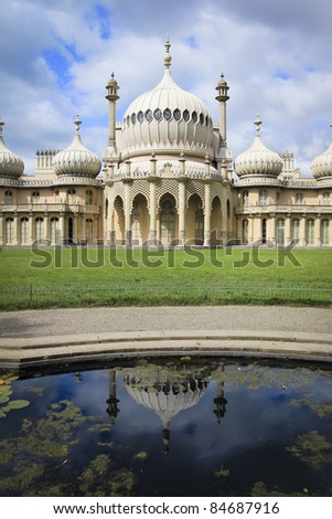 brightons regency period royal pavilion reflected in pond in sussex england - stock photo