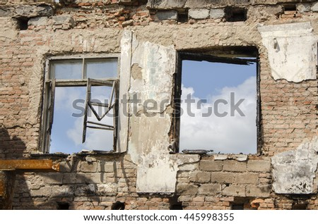 Briks wall and windows after fire - stock photo