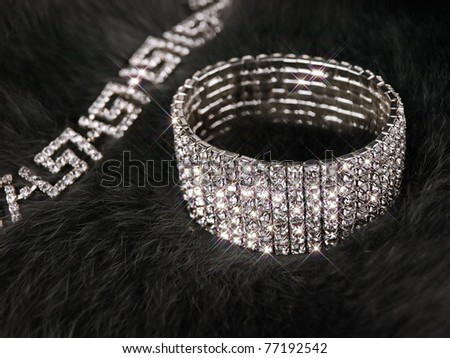 brilliant bracelet and necklace at grey fox fur - stock photo