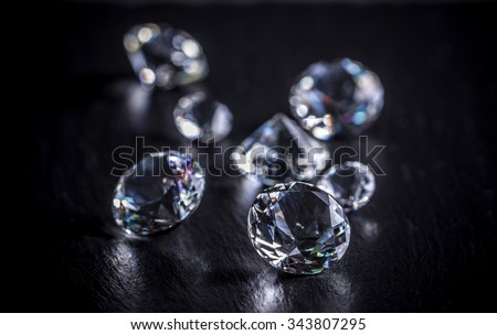 Brilliant diamond on black background - stock photo