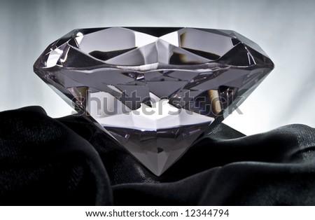 Brilliant Diamond on Black Satin - stock photo