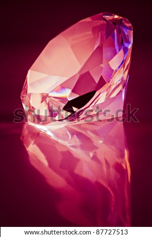 brilliant diamond on dark red background - stock photo