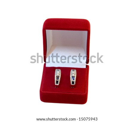 Brilliant earrings with sapphire in box - stock photo