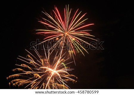 Brilliant fireworks in night sky with copy space. - stock photo