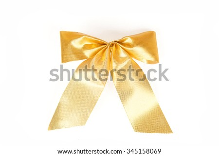 Brilliant gold bow - a Christmas ornament. Yellow ribbon gift bow isolated on white background