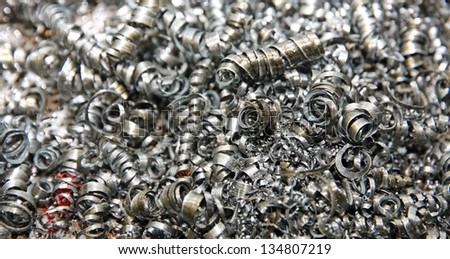 brilliant iron shavings into an industrial lathe - stock photo