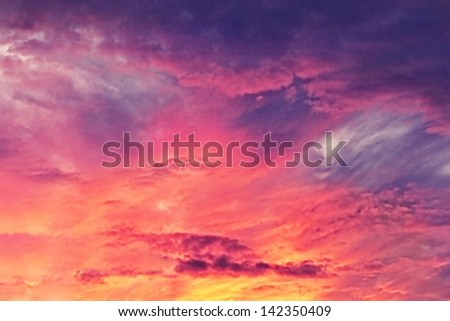 Brilliant sky at sunset or sunrise background wallpaper - stock photo