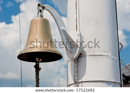 brilliant yacht bell hanging on a rope - stock photo