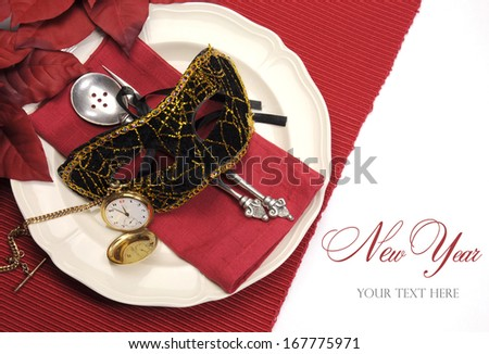 Bring in the New Year dining table place setting with masquerade mask, retro vintage pocket watch clock and fine china and antique silverware in a red, black and gold theme. - stock photo