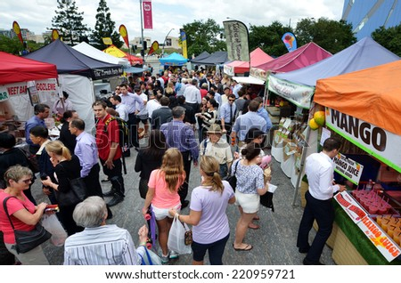 BRISBANE, AUS - SEP 25 2014: People shopping at Jan Powers Farmers Market in Brisbane City.It provide the best produce in Queensland of fresh fruits, vegetables and food to Brisbane, Australia. - stock photo