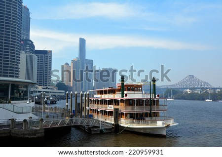 BRISBANE, AUS - SEP 25 2014: Riverboat mooring at Eagle Street Pier.It is an iconic waterfront precinct with world class dining options and unrivaled views of the Brisbane River. - stock photo