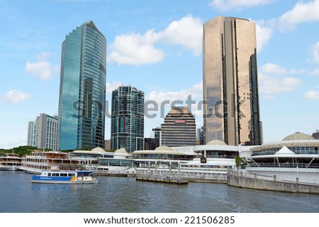 BRISBANE, AUS - SEP 25 2014:Riverboats mooring at Eagle Street Pier.It is an iconic waterfront precinct with world class dining options and unrivaled views of the Brisbane River. - stock photo