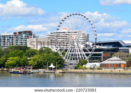 BRISBANE, AUS - SEP 25 2014:Wheel of Brisbane.Its 42 capsules providing a total passenger capacity of 336.The ride lasts for approximately 12 minutes and provides 360 degree views across Brisbane,Australia - stock photo