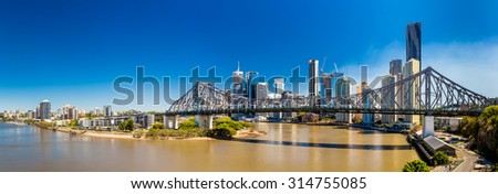 BRISBANE, AUS - SEPTEMBER 9 2015: Panoramic view of Brisbane Skyline with Story Bridge and the river. It is Australias third largest city, capital of Queensland. - stock photo
