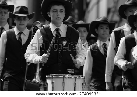 BRISBANE, AUSTRALIA - APRIL 25 : Drummer boy playing march tune during Anzac day centenary