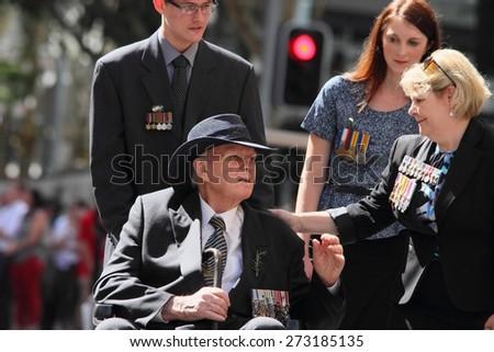 BRISBANE, AUSTRALIA - APRIL 25 : Intergenerational support to older veteran during Anzac day centenary commemorations April 25, 2015 in Brisbane, Australia - stock photo