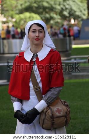 BRISBANE, AUSTRALIA - APRIL 25 : Unidentified World War 2 nurse reenactor poses during Anzac day commemorations  April 25, 2013 in Brisbane, Australia - stock photo