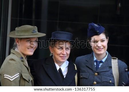 BRISBANE, AUSTRALIA - APRIL 25 : Unidentified World War 2 reenactors pose during Anzac day commemorations  April 25, 2013 in Brisbane, Australia - stock photo